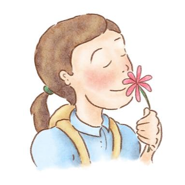 Clara smelling a flower