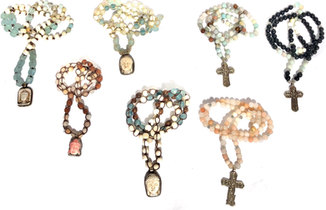 beaded resin buddhas and silver crosses