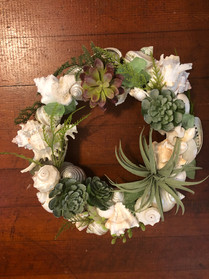 faux plants and seashell wreath