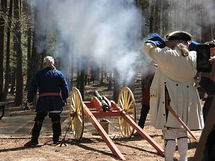 Shooting old cannon at re-enactment of French and Indian War battle