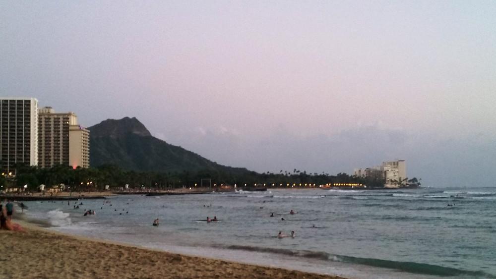 Looking towards Diamondhead while standing on the white sand beaches of Waikiki