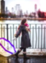 Emily Ellet walks along the river in New York City