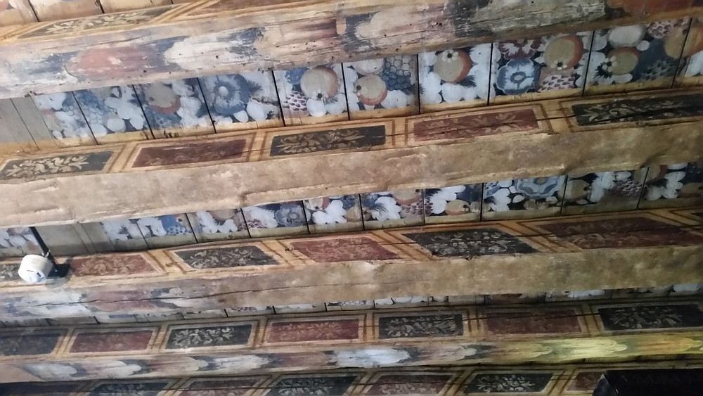 The painted ceiling was discovered when they pulled down a false ceiling that had been added later by an owner too lazy to paint the original.  What a find!