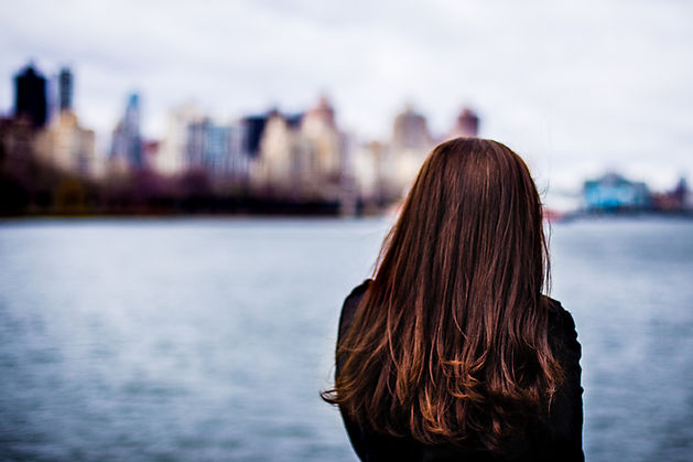 Emily Ellet looks across the river at the New York City skyline