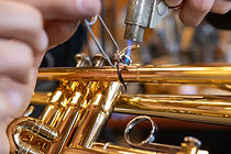 A pinky hook on a student trumpet being