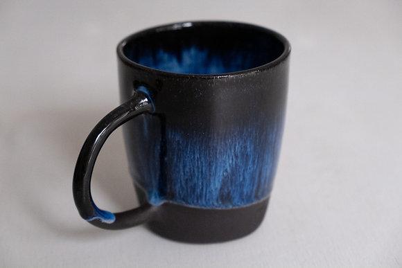 Floating blue black mug