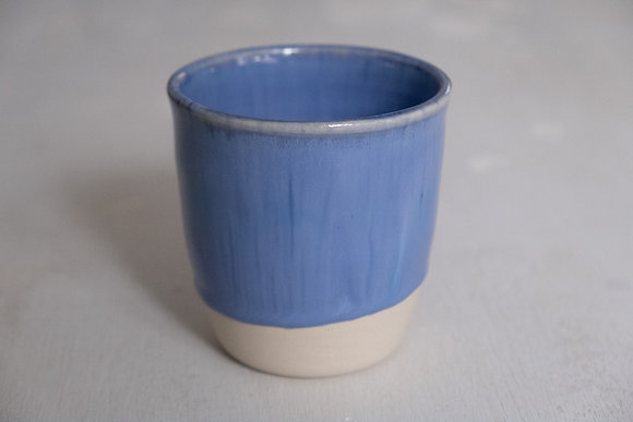 Floating blue white cup