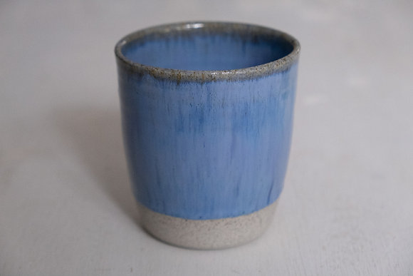 Floating blue speckled cup