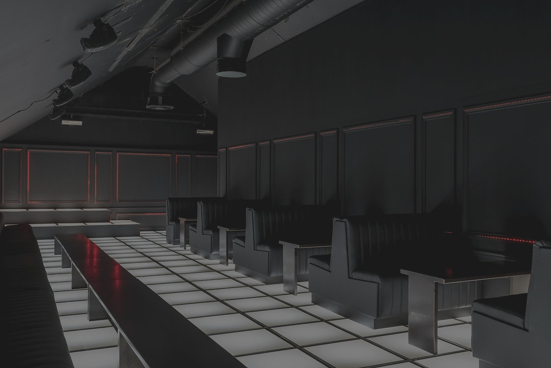 Nightclub and bar design. Contrast. LED lighting and dark fixed seating