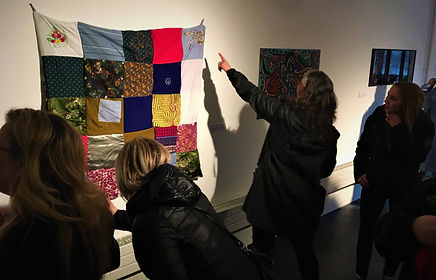 a quilt embroidered by survivors of abuse