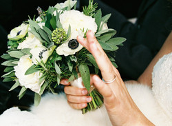 Brides bouquet of anenomie and roses