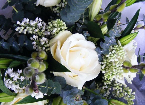 bouquet of white roses and lily with eucalyptus