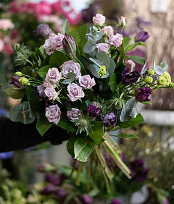 Bouquet of lilac roses and tulips