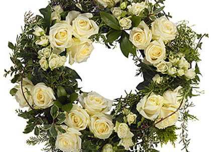 classic white wreath containing white roses and white spray roses