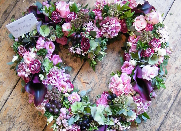 heart shaped funeral tribute in burgundy and pink