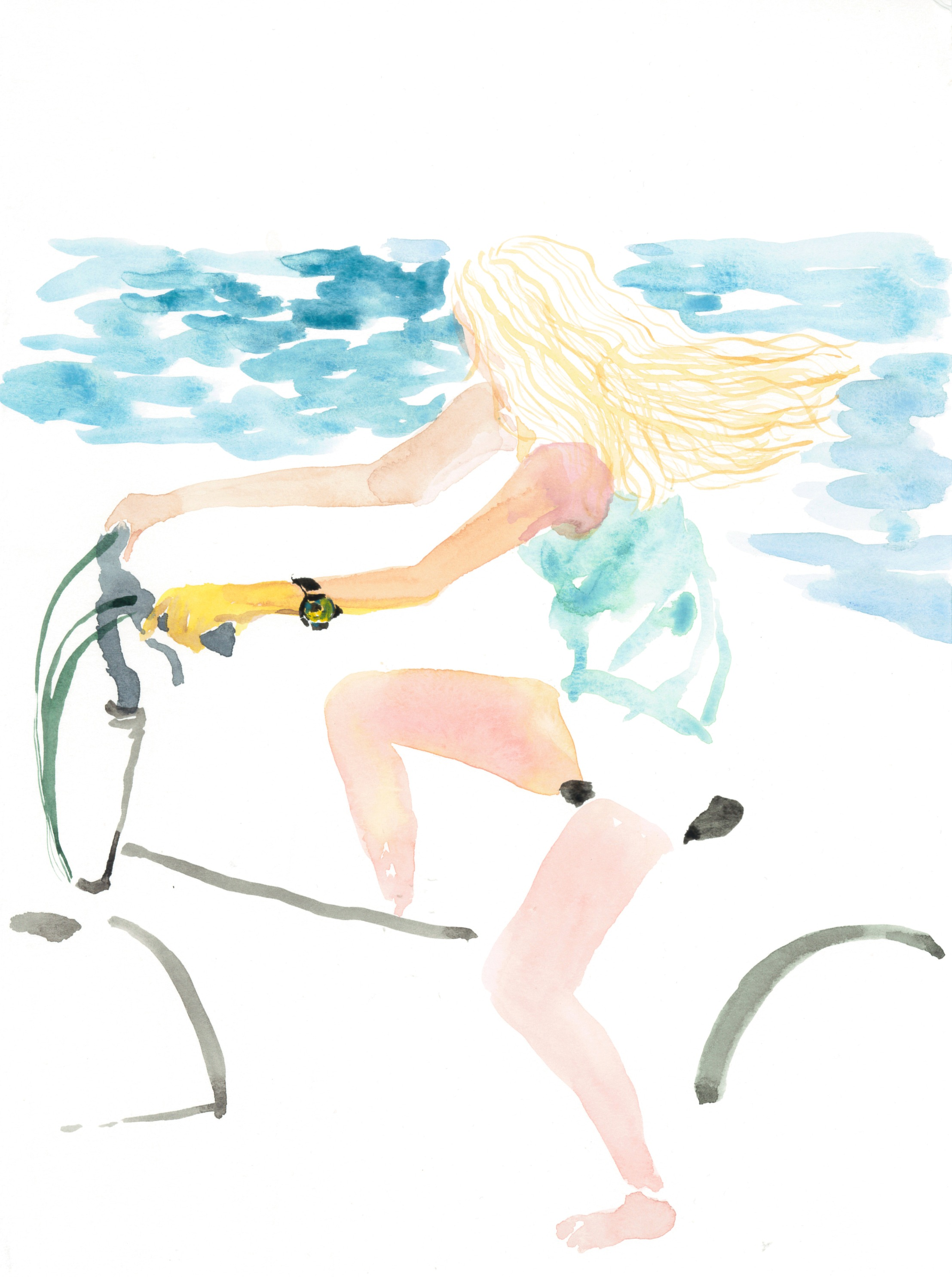 A cycling girl on the beach