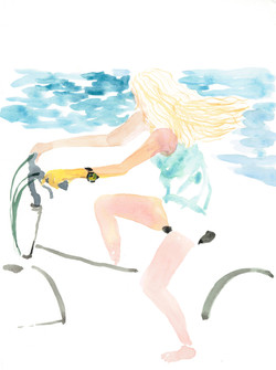 A cycling girl on the beach