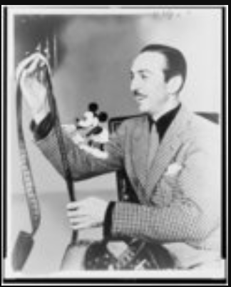 1935. Library of Congress.  Walt Disney examines Film with Mickey Mouse on his shoulder.