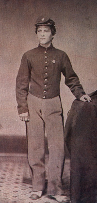 An image of a man in black and white. wearing the uniform of the union army