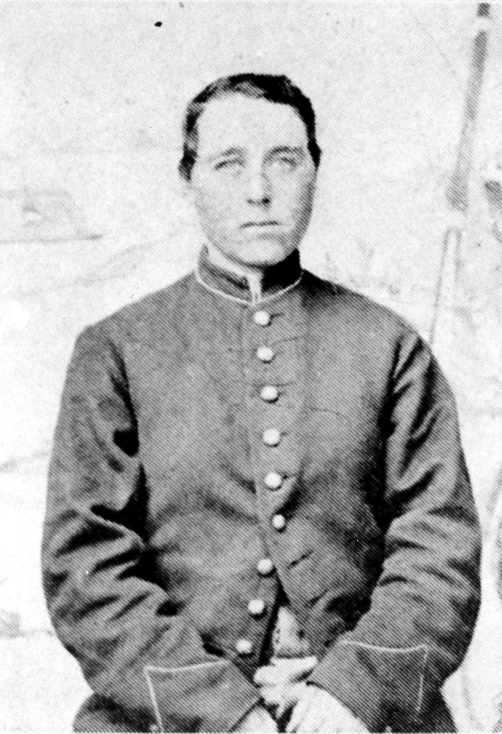 A black and white photograph of a young Albert Cashier wearing military uniform.