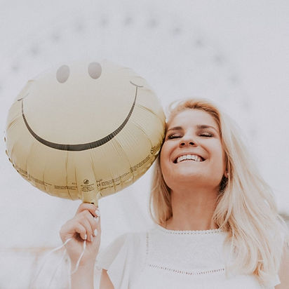 happy woman w baloon.jpg
