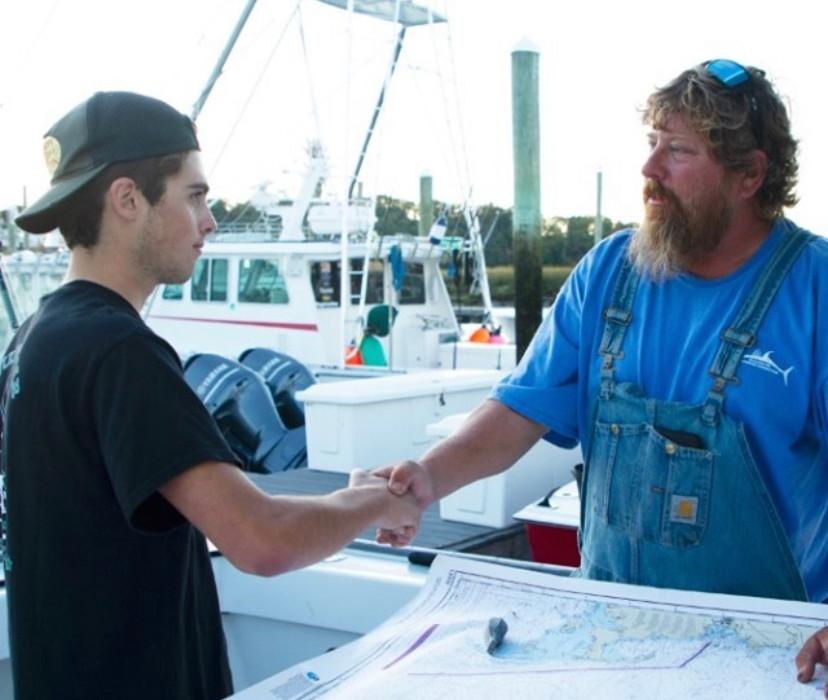 DannyJr and Capt Johnny Shaking hands.jp