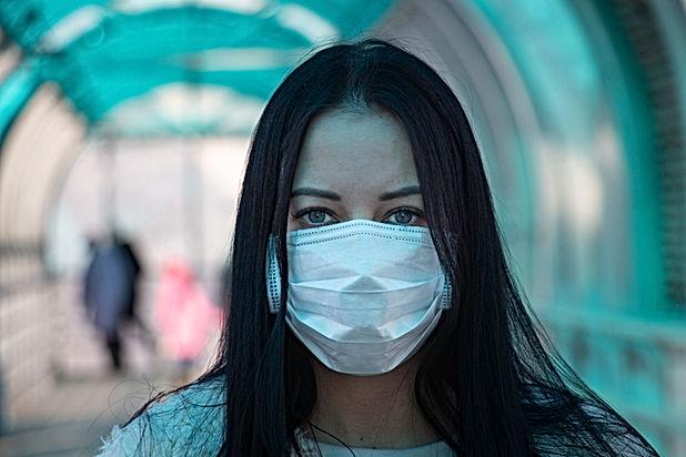 COVID-19_(Coronavirus)_Girl_in_mask.jpg