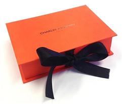 Cajas rígidas naranjas con lazo de cinta.jpg