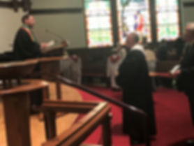 Rev. Roger Grandia listens as Rev. Dan Jesso begins the Prayer of Installation.