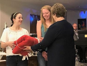 Barb Moss gives fleece blankets to high school senior at Westminster Prebyterian Church.