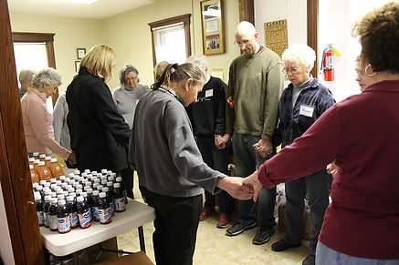 The circle of prayer is part of opening time at Loaves and Fishes in Cedar Rapids, IA.
