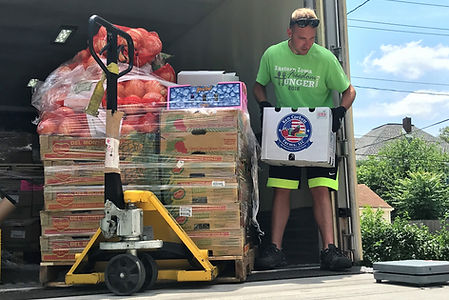 HACAP driver unloads produce at Loaves and Fishes Food Pantry at Westminster Church.