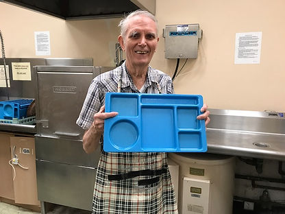 Basil Tilley, member of Westminster Presbyterian Church cleans dishes.