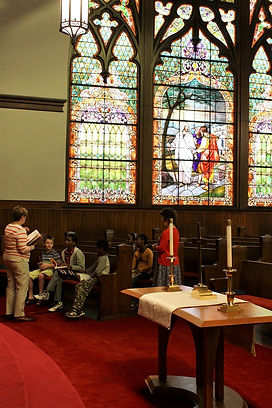 Sunday Schools students learn about the Road to Emmaus story that inspired the stained glass window at Wesminster Presbyterian Church, Cedar Rapids, IA.