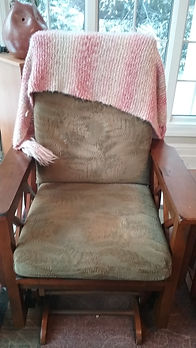 Prayer Shawl made by Westminster ministry is draped over a member's chair.