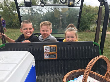 Three kids on the gator.jpg