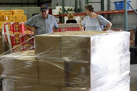 Al Boyden and Connie Hayes load up food at HACAP.