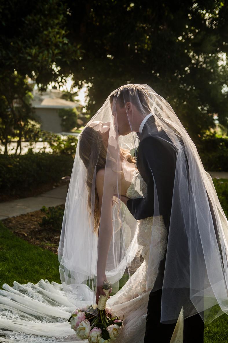San Diego Wedding Photographer, Best of 2018 wedding photography, Berlynn Photography, San Diego Wedding Photography, bride and groom kiss under veil at thursday club