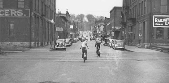 Historic photo. Downtown Stillwater. Group of boys bicycling down chestnut St.