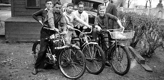 Historic photo. Group of boys posing with bicycles.