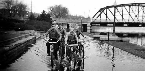Historic Photo. Boys bicycling down flooded levy in Stillwater.