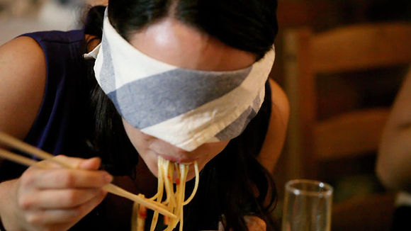 Person Eating Blindfolded