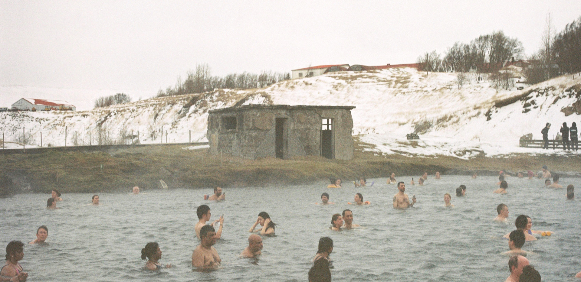 Tourists bathing in the Secret Lagoon