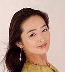 Mariko Headshot bust green.jpg