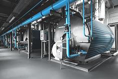 Modern industrial gas boiler room equipe