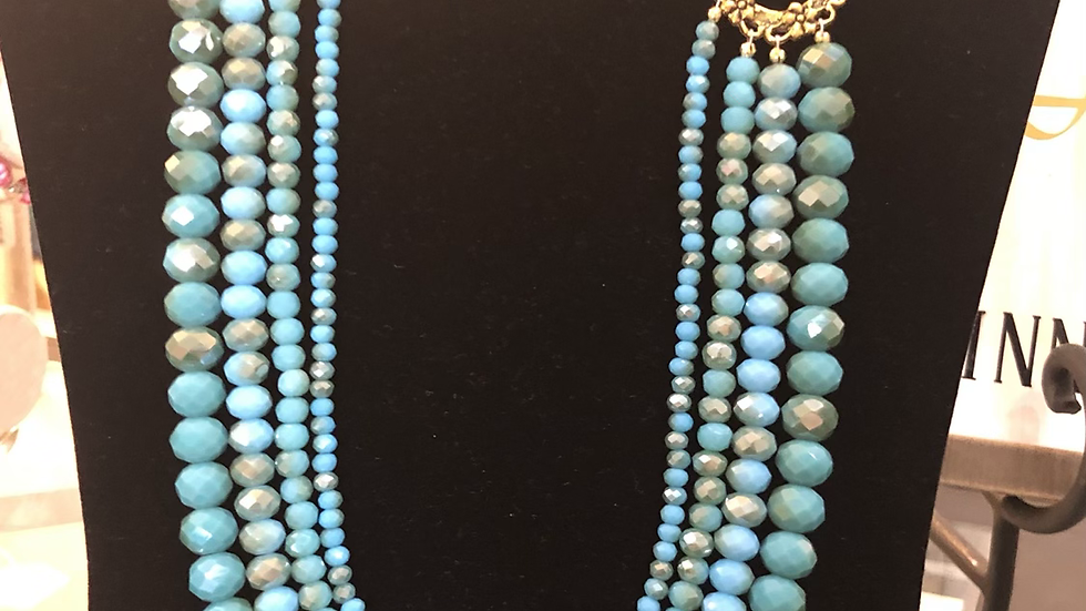 Turquoise and gold four strand necklace and earring set
