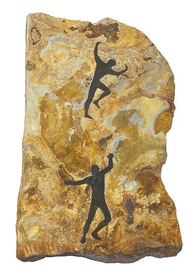Climbers painting on sandstone