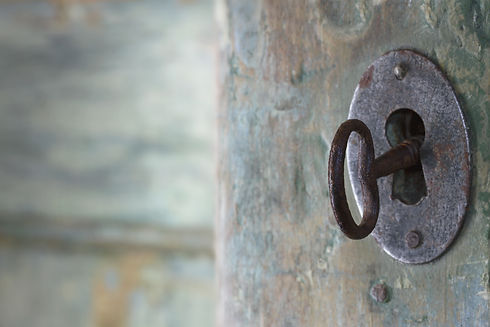 Old green wooden antique door opening with light shining through