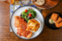 Flat lay of chicken parmigiana, bowl of