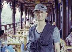 Chenggang Xiao - Director - Back tom Hom